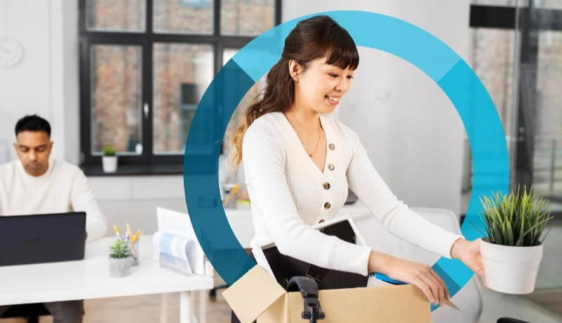 Woman smiling packing possessions